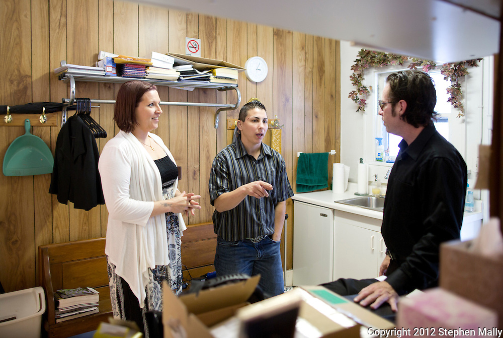 Brigg McDonald (from left) and Stephany Lee talk with Rev. Jonathan Harnish before their wedding ceremony at a wedding chapel in Cedar Rapids on Monday, April 23, 2012.