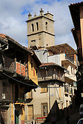 Church tower traditional houses with balconies, Garganta la Olla, La Vera, Extremadura, Spain