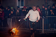 Stonehaven Fireball ceremony - a unique event in Scotland, Stonehaven greets the New Year with approximately 40 men and women parading up and down the High Street while swinging flaming balls around their heads at midnight as the New Year starts.