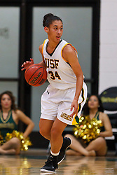 Nov 16, 2011; San Francisco CA, USA;  San Francisco Lady Dons forward Whitney Daniels (34) dribbles the ball against the Cal Poly Mustangs during the first half at War Memorial Gym.  Cal Poly defeated San Francisco 80-66. Mandatory Credit: Jason O. Watson-US PRESSWIRE