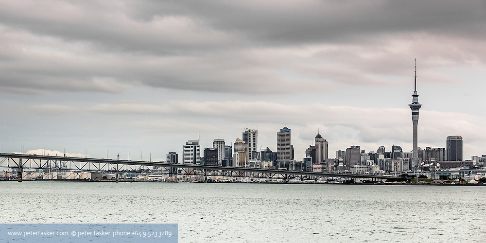 Downtown Auckland, Sky Tower, and the Auckland Harbour Bridge, photographed from the upper Harbour.