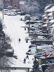 © Licensed to London News Pictures. 01/02/2019. High Wycombe, UK. Residents clear snow from a steep road in High Wycombe, Buckinghamshire after overnight snow falls and continuing low temperatures. Photo credit: Peter Macdiarmid/LNP