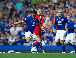 LIVERPOOL, ENGLAND - Saturday, October 1, 2011: Liverpool's Craig Bellamy in action against Everton's Tim Cahill during the Premiership match at Goodison Park. (Pic by David Rawcliffe/Propaganda)
