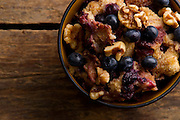 Organic Granola dish with fruit on a rustic table