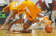 "Ole Miss guard Zach Graham (32) and Tennessee's Melvin Goins (2) go for the ball at the C.M. ""Tad"" Smith Coliseum in Oxford, Miss. on Satursday, January 29, 2011.  (AP Photo/Oxford Eagle, Bruce Newman)"