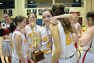 Gwynedd Mercy players celebrate as they hold the trophy after winning the District One Class AAA girls basketball championship game by defeating Villa Marie 54-37 Saturday February 27, 2016 at Council Rock South in Northampton, Pennsylvania. (Photo by William Thomas Cain)