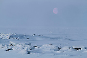 Moonrise over sea ice in Unalakleet, Alaska during Iditarod 2012.