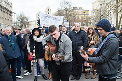 Whitehall, London, February 10th 2016. Protesters sing outside Downing Street as an estimated 8,000 cabbies hold a go-slow in protest against what they say is unfair competition from minicab and Uber drivers who do not have to undergo the rigorous training and checks required for the licenced taxi trade. ///FOR LICENCING CONTACT: paul@pauldaveycreative.co.uk TEL:+44 (0) 7966 016 296 or +44 (0) 20 8969 6875. ©2015 Paul R Davey. All rights reserved.