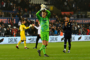 Bailey Peacock-Farrell (1) of Leeds United applauds the Leeds fans after a 2-2 draw during the EFL Sky Bet Championship match between Swansea City and Leeds United at the Liberty Stadium, Swansea, Wales on 21 August 2018.