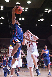 November 18, 2010; Stanford, CA, USA;  Virginia Cavaliers guard Jontel Evans (1) shoots past Stanford Cardinal forward Andrew Zimmermann (34) during the second half at Maples Pavilion.  Stanford defeated Virginia 81-60.