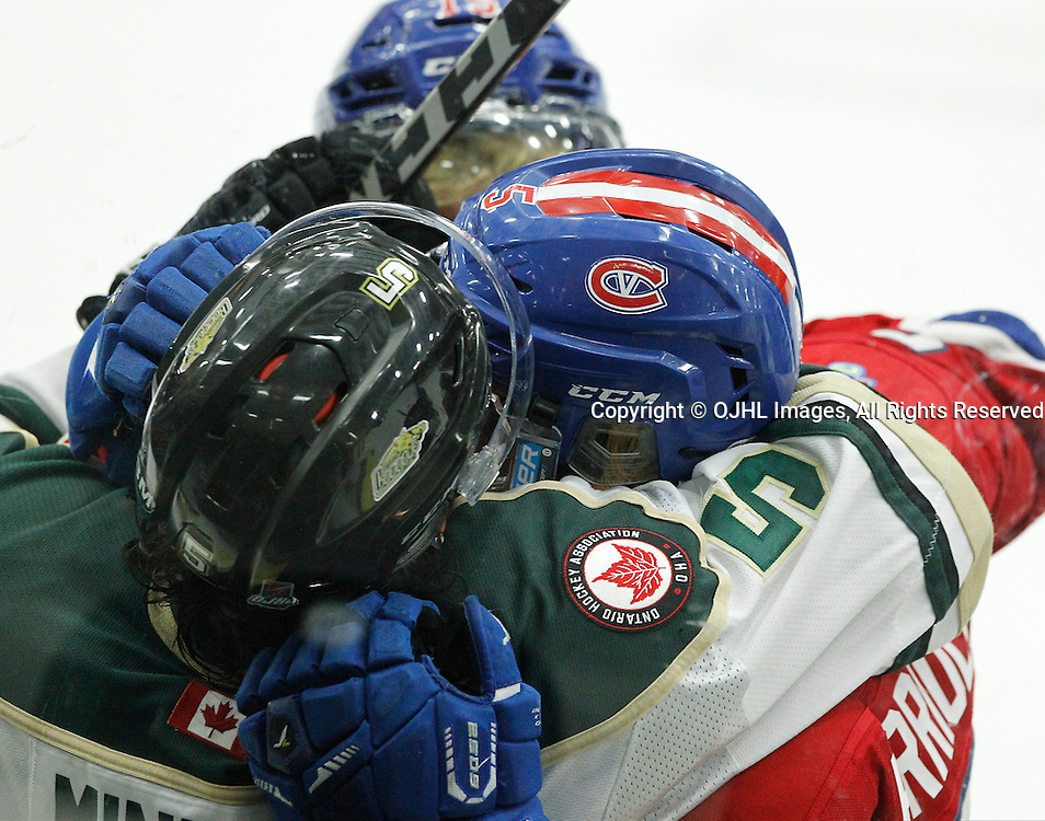COBOURG, ON  - MAR 4,  2017: Ontario Junior Hockey League, playoff game between the Cobourg Cougars and the Kingston Voyageurs. Anthony Firriolo #5 of the Kingston Voyageurs and Nick Minerva #5 of the Cobourg Cougars becomes involved in an altercation during the third period.<br /> (Photo by Tim Bates / OJHL Images)