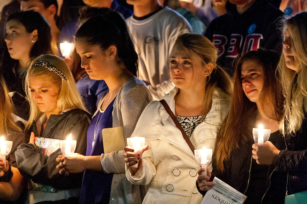 Rachel Wilson(second from right) and Courtney Gaskill(right) mourn the death of UK student Jonathan Krueger during a memorial service in his honor at Memorial Hall in Lexington, Ky. Krueger was murdered days before while walking home on Transylvania Park.