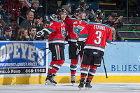 KELOWNA, CANADA - NOVEMBER 30: Carter Rigby #11,  Rourke Chartier #14 and Riley Stadel of the Kelowna Rockets celebrate a goal against the Kamloops Blazers on November 30, 2013 at Prospera Place in Kelowna, British Columbia, Canada.   (Photo by Marissa Baecker/Shoot the Breeze)  ***  Local Caption  ***