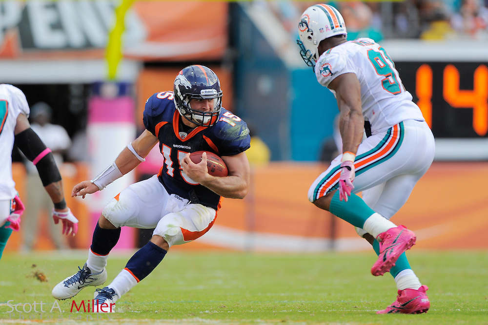 Denver Broncos quarterback Tim Tebow (15) is pressured by Miami Dolphins outside linebacker Jason Taylor (99) during their game at Sunlife Stadium on Oct. 22, 2011 in Miami Gardens, Fla.  Denver won 18-15 in over time...©2011 Scott A. Miller
