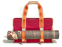 red and orange handbag with yoga mat