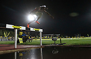 STELLENBOSCH, SOUTH AFRICA, Tuesday 20 March 2012, Ruben Ramolefi hurdles the water jump in the mens 3000m steeplechase  during the Yellow Pages Series athletics meeting at the University of Stellenbosch Coetzenburg stadium..Photo by Roger Sedres/Image SA
