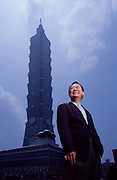 "World-renowned architect CP Wang of CY Lee & Partners stands in front of Taipei 101, which at 508 meters, stands the tallest building in the world. The jade green bamboo-inspired exterior connotes vigor and sturdiness in Chinese culture. Good idea for a tower that stands 200 meters from a major fault line in a city prone to typhoons. Lee designed eight stories to each of the eight segments because the number ""8"" signifies prosperous growth. Each segment is shaped like a scepter, with ancient coins on the exterior of the 26th floor to give this modern building a Chinese style."