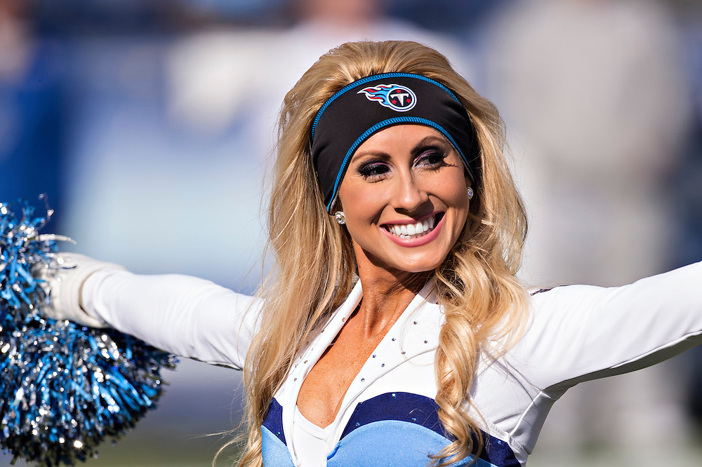 NASHVILLE, TN - DECEMBER 29:  Cheerleader of the Tennessee Titans performs before a game against the Houston Texans at LP Field on December 29, 2013 in Nashville, Tennessee.  The Titans defeated the Texans 16-10.  (Photo by Wesley Hitt/Getty Images) *** Local Caption ***