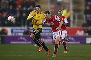 Middlesbrough midfielder, on loan from Southampton, Gaston Ramirez (21) and Rotherham United midfielder Richard Smallwood (33)  during the Sky Bet Championship match between Rotherham United and Middlesbrough at the New York Stadium, Rotherham, England on 8 March 2016. Photo by Simon Davies.