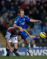 Photo: Glyn Thomas.<br />Aston Villa v Chelsea. Barclays Premiership. 01/02/2006.<br />Chelsea's Arjen Robben (R) battles for the ball with Olof Mellberg.