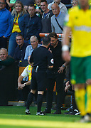 /referee Keith Stroud talks to Norwich City's manager Daniel Farke during the EFL Sky Bet Championship match between Norwich City and Hull City at Carrow Road, Norwich, England on 14 October 2017. Photo by John Marsh.