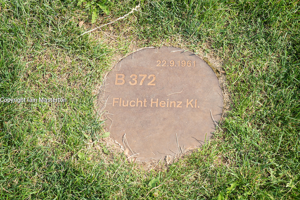 Plaque marks location of escape of Heinz Kl. in  former death strip of Berlin Wall on Bernauer Strasse and Ackerstrasse in Berlin Germany