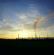 The sun setting at the Shell manufacturing complex at the Stanlow next to the river Mersey in Cheshire. The Mersey is a river in north west England which stretches for 70 miles (112 km) from Stockport, Greater Manchester, ending at Liverpool Bay, Merseyside. For centuries, it formed part of the ancient county divide between Lancashire and Cheshire.