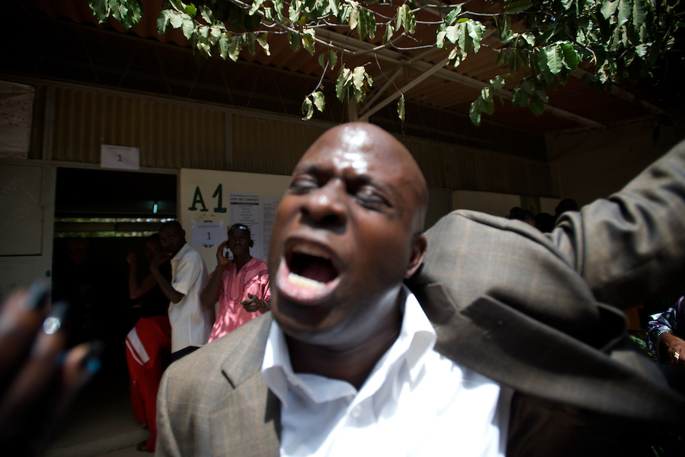 February 26, 2012 - Dakar, Senegal: A senegalese man shouts insults against the president and candidate, Abdoulaye Wade, while votingat the Franco-Arab School in Point E area of Dakar. Hundreds of people queueing for voting insulted and heckled Wade, accusing the head of state of disrespect for the country's constitution when running for a third mandate. (Paulo Nunes dos Santos/Polaris)