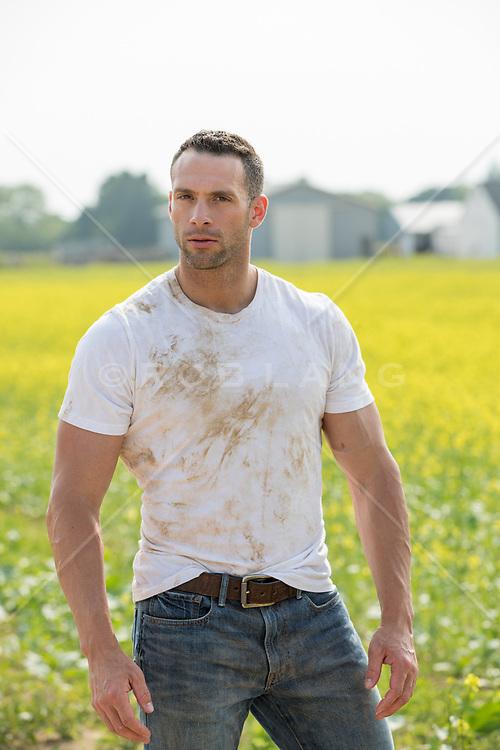 hot farmer in a dirty tee shirt on a farm