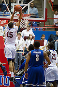 Cannen Cunningham #15 of the SMU Mustangs dunks the ball against the Memphis Tigers at Moody Coliseum on Wednesday, February 6, 2013 in University Park, Texas. (Cooper Neill/The Dallas Morning News)