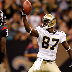 August 21, 2010; New Orleans, LA, USA; New Orleans Saints wide receiver Adrian Arrington (87) gestures in front of Houston Texans safety Bernard Pollard (31) after a big gain during the second quarter of a preseason game at the Louisiana Superdome. Mandatory Credit: Derick E. Hingle