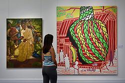 "© Licensed to London News Pictures. 12/05/2017. London, UK.   A staff member views (L to R) ""Nkrumah"", 1962, by Uzo Egonu (Est.  GBP 10-15k) and ""Cours Familiale"", 2014, by Boris Nzebo (Est. GBP 8-12k) at the preview for the first sale dedicated to Modern and Contemporary African Art at Sotheby's New Bond Street.  The sale features over 115 artworks by over 60 different artists from 14 countries across the continent. Photo credit : Stephen Chung/LNP"