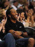 Mar. 21 2010; Phoenix, AZ, USA; Arizona Cardinals wide receiver Larry Fitzgerald sits court side during the game at the US Airways Center.   Mandatory Credit: Jennifer Stewart-US PRESSWIRE.