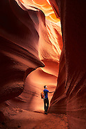 A hiker discovers the natural beauty of Antelope Canyon, Page, Arizona.