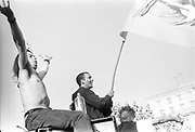 Men on top of sound system with flag, First Criminal Justice March, Trafalgar Square, London, UK, First of May 1994.