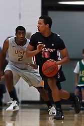 Dec 10, 2011; San Francisco CA, USA;  Pacific Tigers guard Markcus Falley (10) is defended by San Francisco Dons guard Avery Johnson (2) during the first half at War Memorial Gym.  Mandatory Credit: Jason O. Watson-US PRESSWIRE