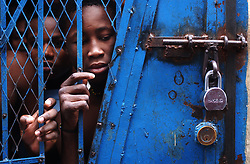 Prisoners are held in a jail at a police station in downtown Port Au Prince.  They complained to visiting UN police officers that they are being illegaly held longer than the constitution allowed and that they haven't been to court.  The security situation in Haiti has deteriorated in the past few months with many Hatians and human rights groups accusing the Haitian National Police of human rights violations.   Some Hatians who live in the most dangerous neighborhoods prasie the UN forces , claiming that when they are present the Hatian police are calmer.