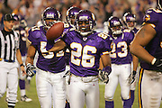 MINNEAPOLIS - NOVEMBER 21:  Cornerback Antoine Winfield #26 of the Minnesota Vikings celebrates after he intercepts a Joey Harrington pass to ice the game against the Detroit Lions at the Hubert H. Humphrey Metrodome on November 21, 2004 in Minneapolis, Minnesota. The Vikings defeated the Lions 22-19. ©Paul Anthony Spinelli  *** Local Caption *** Antoine Winfield