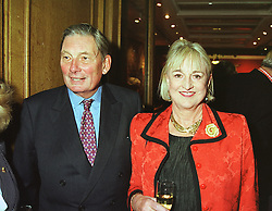 LORD & LADY KELVERDON at a reception in London on 22nd March 1999.MPO 24