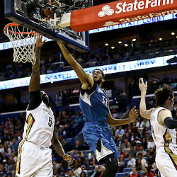 Feb 27, 2016; New Orleans, LA, USA; Minnesota Timberwolves center Karl-Anthony Towns (32) shoots over New Orleans Pelicans forward Luke Babbitt (8) and center Kendrick Perkins (5) during the first half of a game at  the Smoothie King Center. Mandatory Credit: Derick E. Hingle-USA TODAY Sports