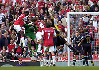 Photo: Olly Greenwood.<br />Arsenal v West Ham United. The Barclays Premiership. 07/04/2007. West Ham's Robert Green saves under pressure from Arsenal players including Jens Lehamnn