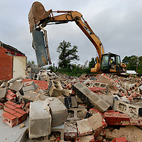 Thomas Wells | BUY AT PHOTOS.DJOURNAL.COM<br /> Tupelo Public Works employee Dennis Carr finishes tearing down what was left of the old Fire Station #4 off North Gloster on Wednesday that was heavily damaged in the April 28