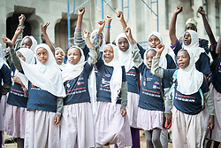 "16 June 2017, Nairobi, Kenya: Children from the Joseph Kangethe School, a public school for muslim and christian children of ages 2-13, participate in the commemoration of the Day of the African Child 2017, in Nairobi. On 16 June, more than 500 people gathered to commemorate the Day of the African Child in Nairobi, Kenya, and to speak up publicly for the rights of children and adolescents living with HIV. Religious leaders from a range of different faith communities and traditions led a march through the streets of Nairobi, from the All Saints Cathedral to Ufungamano House, accompanied by hundreds of youth and young children from local faith-sponsored schools, after which a ceremony was held where the religious leaders committed publicly to work for children's rights to HIV testing, access to treatment, and freedom from stigma and discrimination, to make sure that those who are in need of treatment are also able to stay on treatment. The day was organized by the World Council of Churches Ecumenical Advocay Alliance together with Inerela+ Kenya, with contributions from a range of other partners. At end of the ceremony, the WCC-EAA launched a global Call to Action entitled ""Act now for children and adolescents living with HIV"", which was signed by the range of religious leaders."