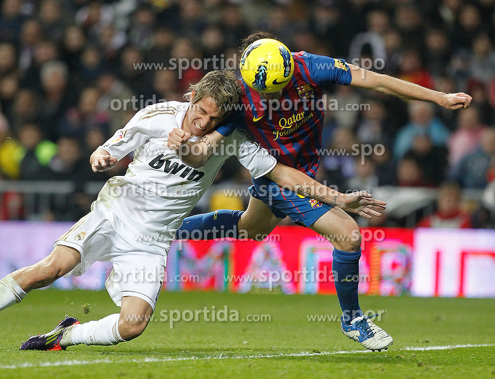 10.12.2011, Santiago Bernabeu Stadion, Madrid, ESP, Primera Division, Real Madrid vs FC Barcelona, 15. Spieltag, im Bild Real Madrid's Fabio Coentrao and FC Barcelona's Cesc Fabregas goal // during the football match of spanish 'primera divison' league, 15th round, between Real Madrid and FC Barcelona at Santiago Bernabeu stadium, Madrid, Spain on 2011/12/10. EXPA Pictures © 2011, PhotoCredit: EXPA/ Alterphotos/ Alex Cid-Fuentes..***** ATTENTION - OUT OF ESP and SUI *****