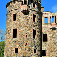 Huntly Castle Round Tower in Huntly, Scotland<br /> Despite being in partial ruins, the Huntly castle is worth seeing.  This five-story round tower was constructed in 1410.  It hints at the grandeur of this former estate owned by the Clan Gordan, a family of Norman knights. Most of the current castle was built by the 1st Earl of Huntly around 1550 and significantly expanded by the 4th and 6th Earls (both named George Gordon) through the early 18th century. Their names are still visible on the fa&ccedil;ade dated 1606. Inside you can see the courtyard, an ornate fireplace, a brew house and the cellar.