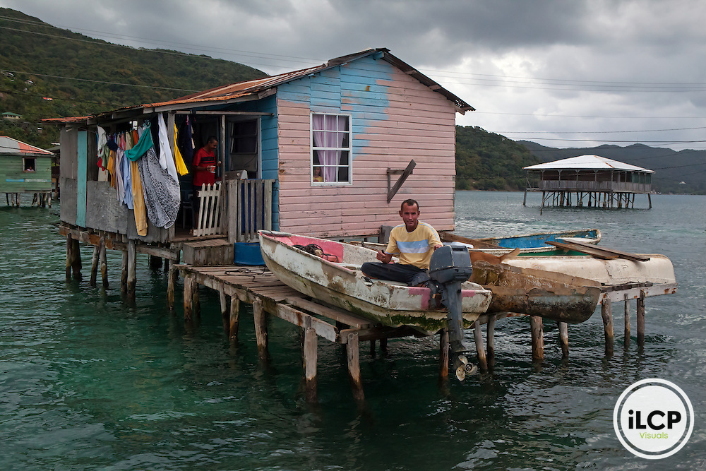 Fishermen inhabiting houses on stilts, Guanaja Island, Bay Islands, Honduras, April