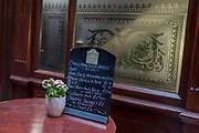 As the Coronavirus pandemic spreads across the UK, businesses and entertainment venues not already closed with the threat of job losses, struggle to stay open with growing rumours of a lockdown and travel restrictions around the capital. As Londoners work from home, drinks tables remain empty at a City of London bar, a normally favourite lunchtime haunt for financial workers, on 19th March 2020, in London, England.