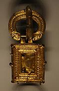 Buckle, silver gilt and garnet.  500-600, Belluno, Italy.