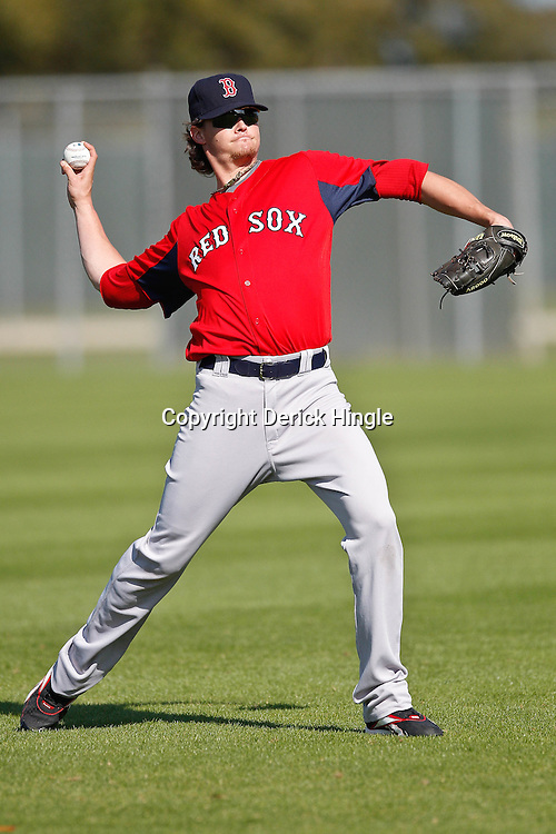 February 18, 2011; Fort Myers, FL, USA; Boston Red Sox starting pitcher Clay Buchholz (11) during spring training at the Player Development Complex.  Mandatory Credit: Derick E. Hingle