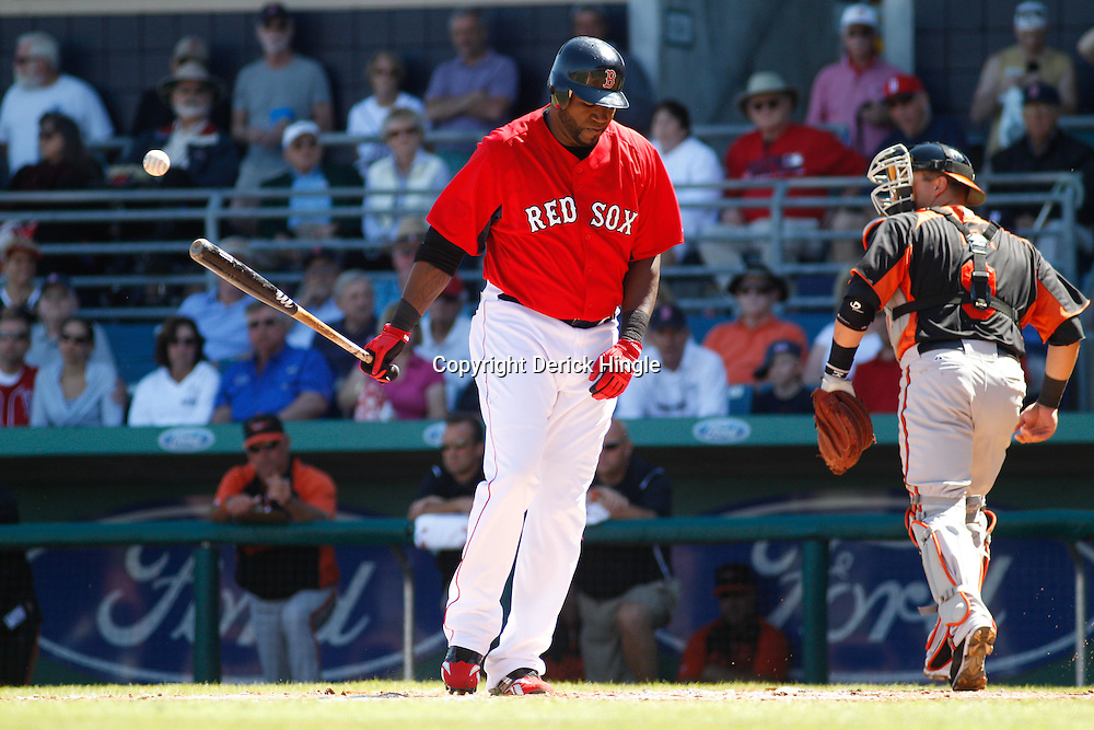 March 7, 2011; Fort Myers, FL, USA; Boston Red Sox first baseman David Ortiz (34) reacts after striking out during a spring training exhibition game against the Baltimore Orioles at City of Palms Park.   Mandatory Credit: Derick E. Hingle